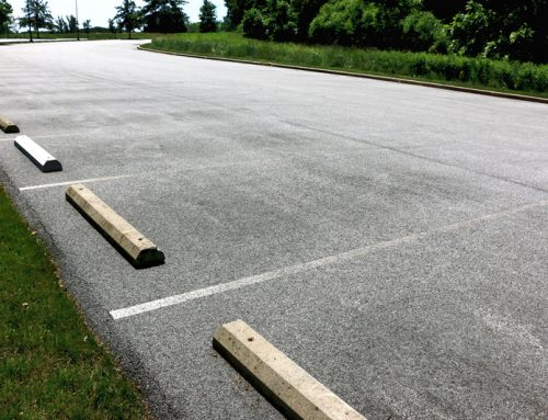 What is the Cement Block in a Parking Lot Called?