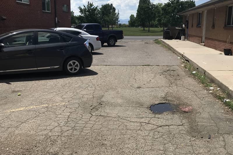 dayton-apartments-denver-co-parking-lot-before