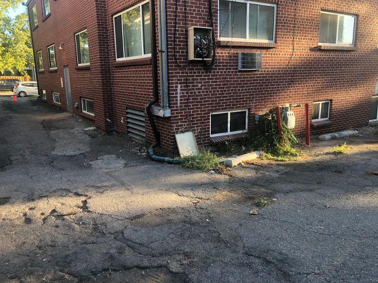 highland-apartments-parking-lot-damaged-asphalt